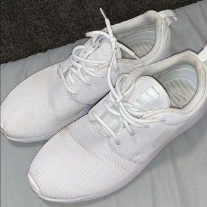White Nike workout shoes